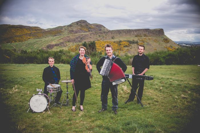 1. 7 Hills Ceilidh Band in front of the Crags
