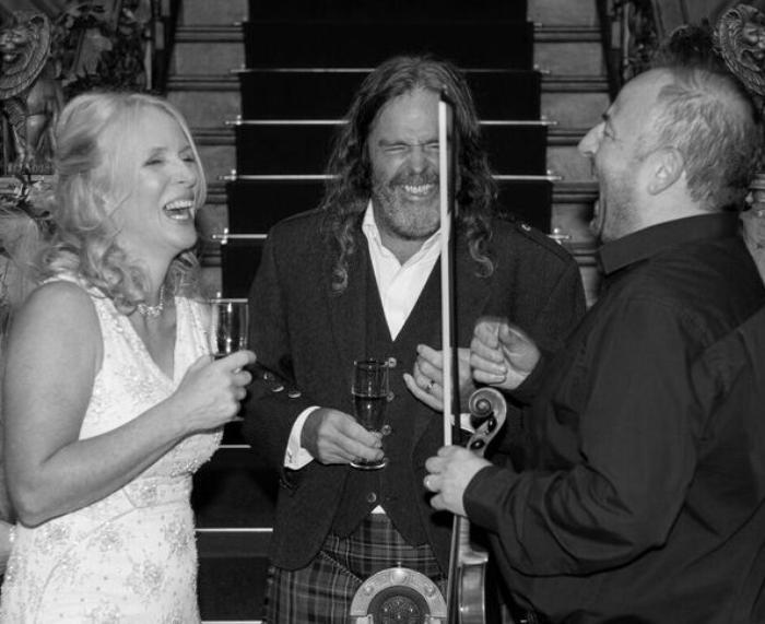 3. Bride and Groom Share a Joke
