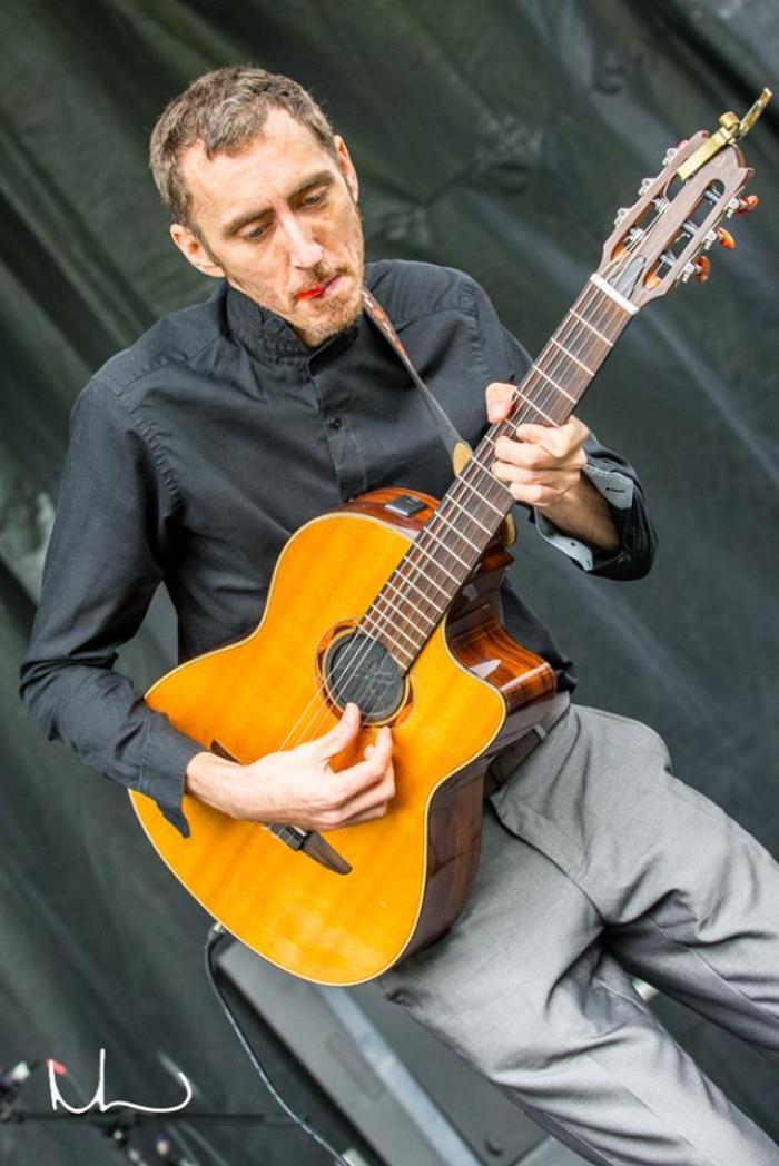 3. Guitarist seeking a chord in the Nth Dimension