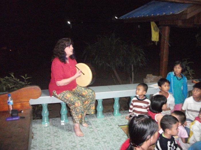 4. Heather singing to orphanage children in Thailand