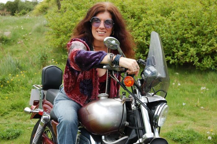 1. On her bike!