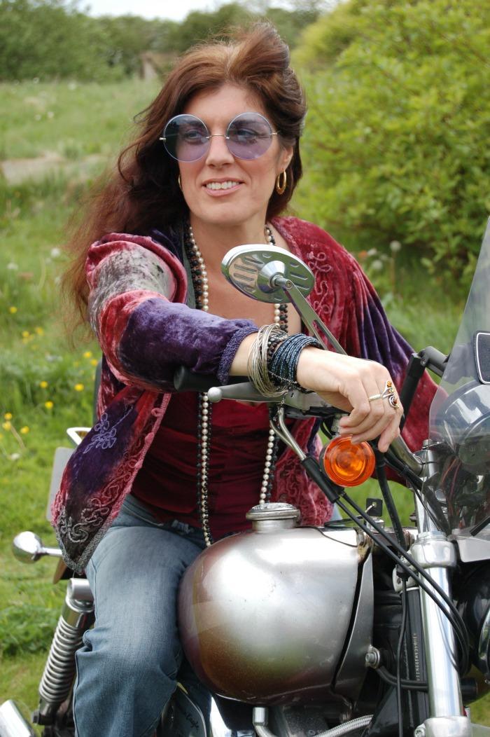 3. On her bike...2!