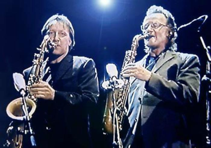 6. Laurent, Logicaltramp sax player on stage with Supertramp, beside  John Helliwell