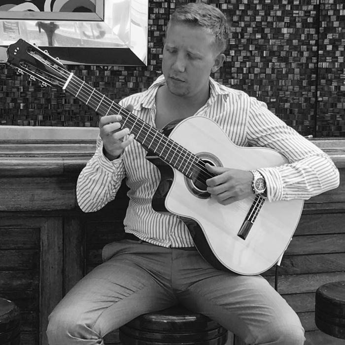 1. Luke Palmer - Classical Guitarist (In Antigua)
