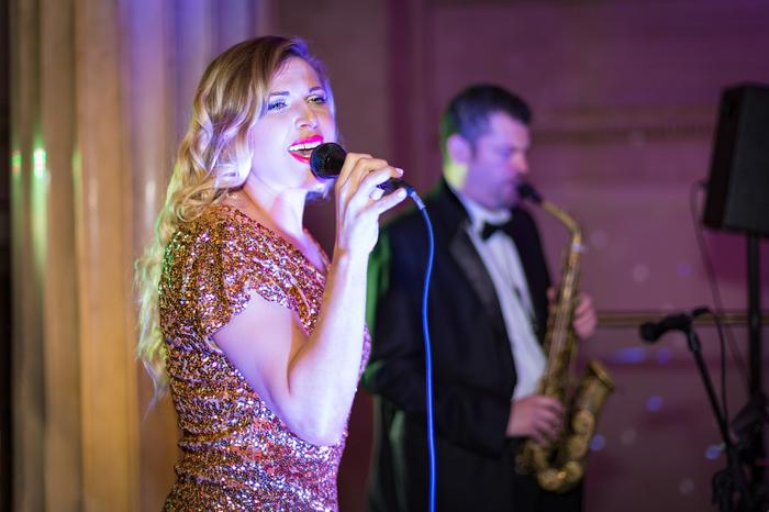2. Glamourous vocals and saxophone
