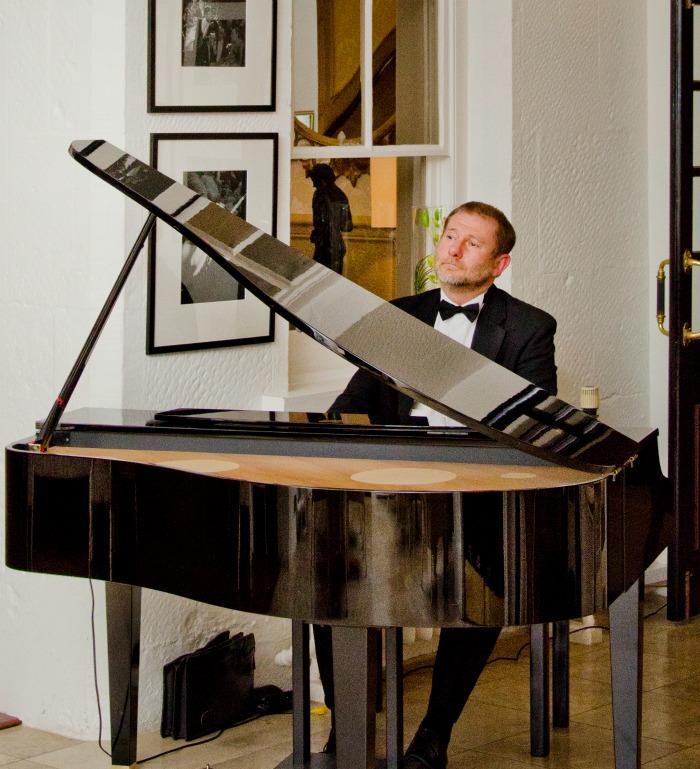 1. Simon Fricker - Champagne Reception