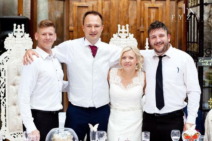 5. tino and mark with the bride and groom