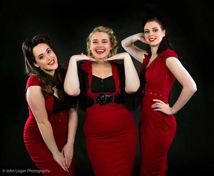 5. The Ragtime Dolls Red Dresses