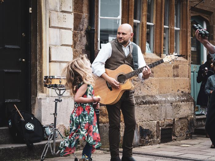 3. Street Festival Guitarist